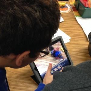 Students working on an iPad