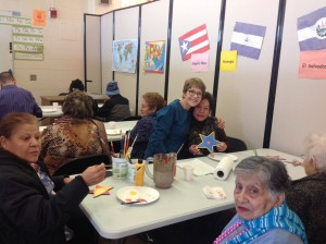 WhyArts? artist Paula Wallace worked with seniors at the Intercultural Senior Center to create star art that was displayed at the Hot Shops Art Center Open House.